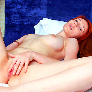 Sexy redhead spreading her pink pussy lips