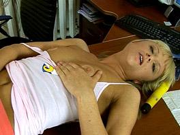Elly masturbates on top of her desk