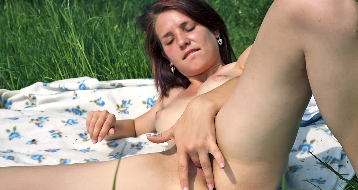 Charlotte plays with her pussy in a park