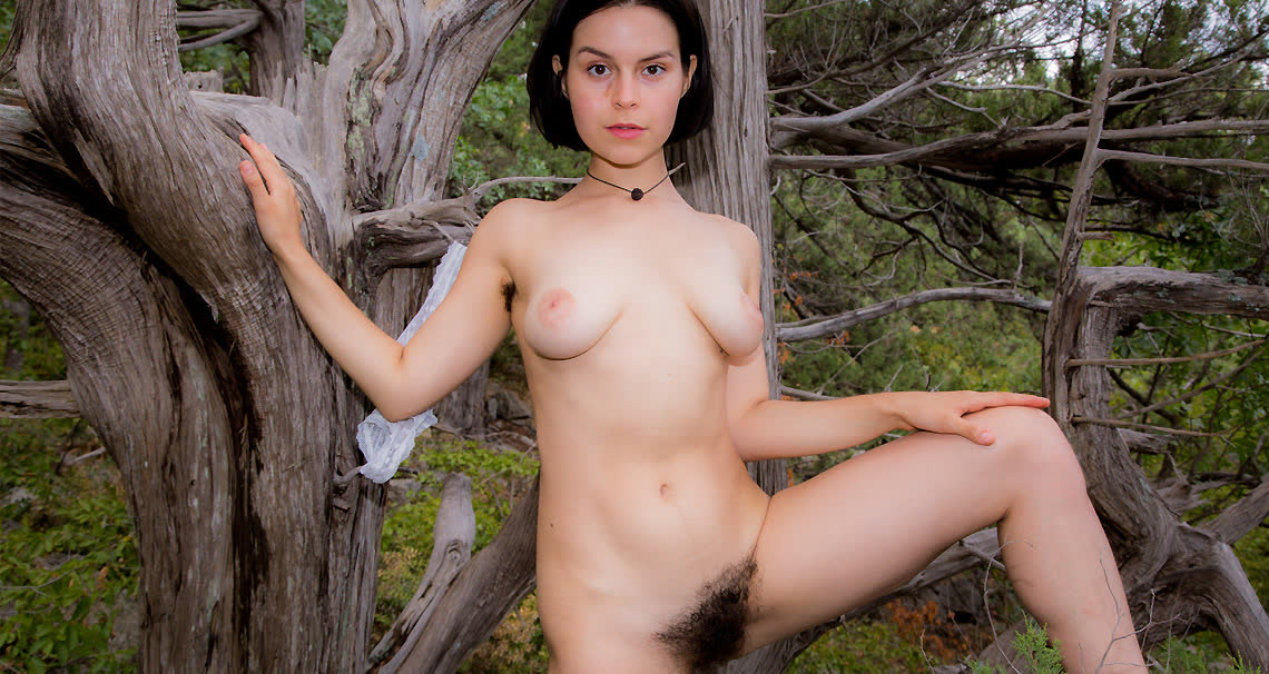 Teen with incredible big natural bush