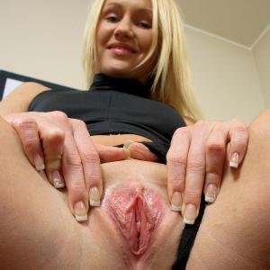 Stunning slut  spreads her pussy wide open