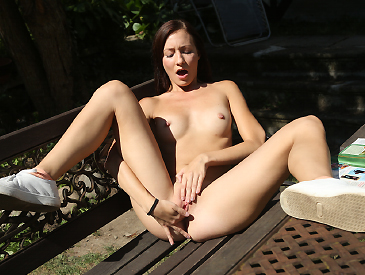 Teen with hard nipples masturbating in the garden