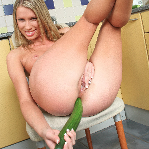 Teen stuffing her ass with a cucumber
