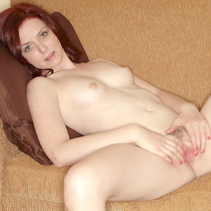 Lovable redhead spreading her pussy wide open