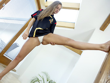 Spanish soccer fan stretching her legs