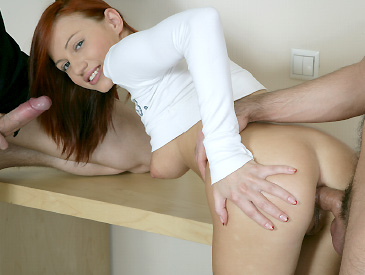 Busty redhead fucked by 2 boners