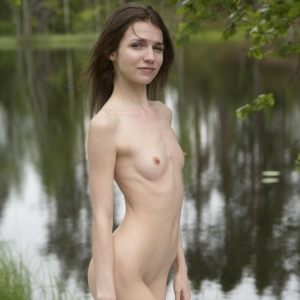 Super skinny girl getting naked outdoors